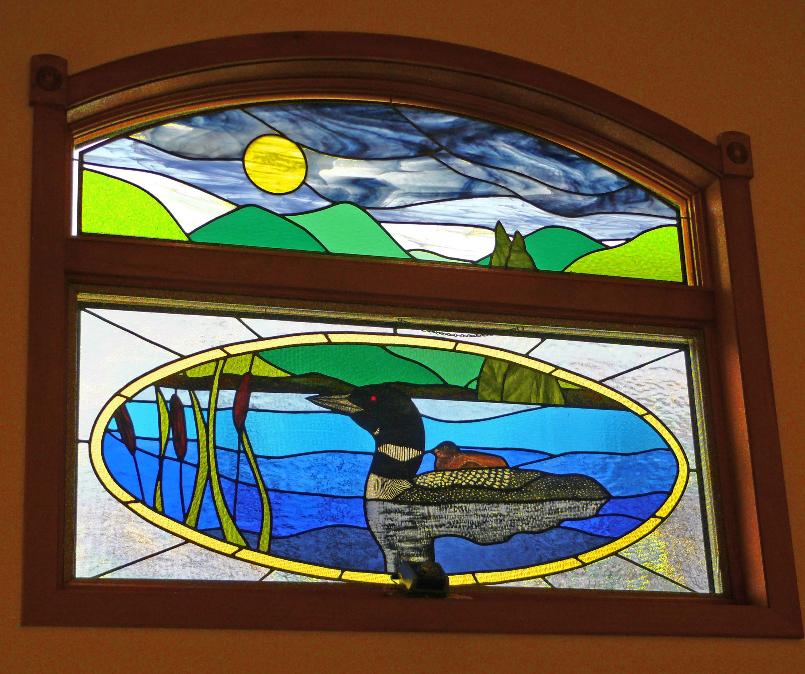 Double window loon and its reflection on the water were hand painted